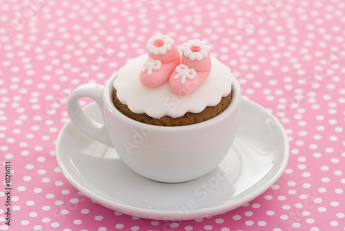 Photo Christening cupcake with pink booties for a girl