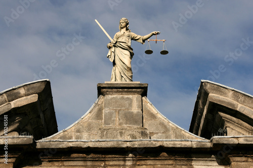 Statue of Justice on Dublin Castle wall. Poster