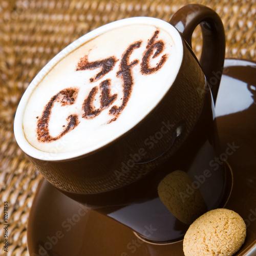 A hot cappuccino with an amaretti