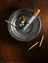 Silver Ashtray With Cigarette ...