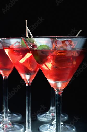 фотография  Martini glasses on black background