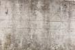 Eine graue Mauer aus Beton für Hintergrund