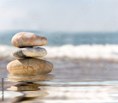 Photo Stands Zen Stack of pebbles on sea background