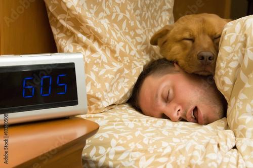 Man and his dog comfortably sleeping in © Michael Pettigrew