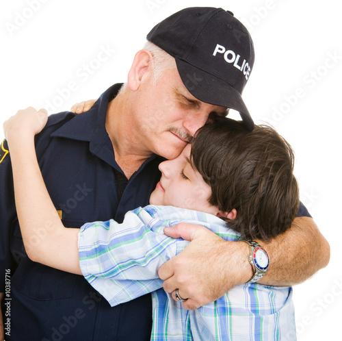 Fényképezés  Policeman hugging an adolescent boy.    Isolated on white.