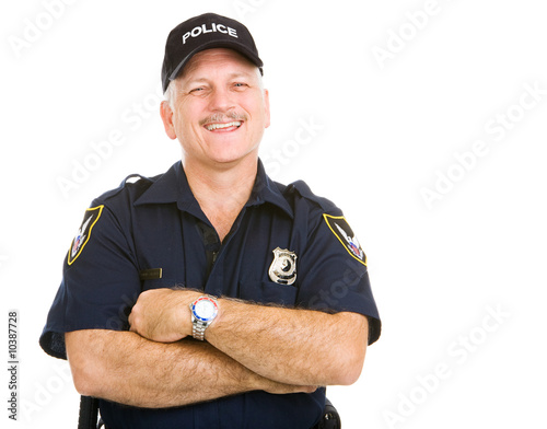 Fototapeta Happy, laughing police officer.  Isolated on white.