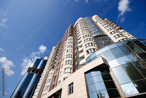 New modern building over blue sky Canvas Print