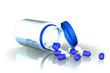 bocal de gélules bleues renversé sur fond blanc