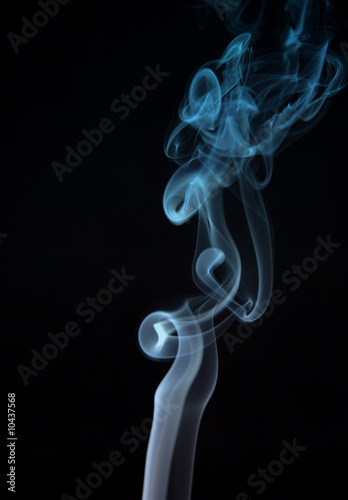 Fotobehang Rook smoke from a cigarette in a black background