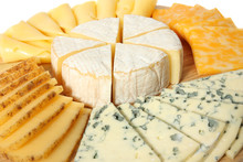 Various Types Of Cheese On Wooden Platter