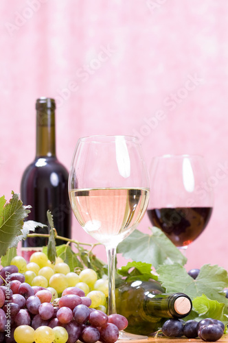 Fototapety, obrazy: Wine glass with red bottle of wine