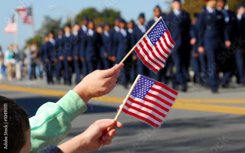 Flag waving at veteran's day parade Wallpaper Mural