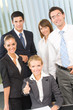 Portrait of cheerful successful business team at office