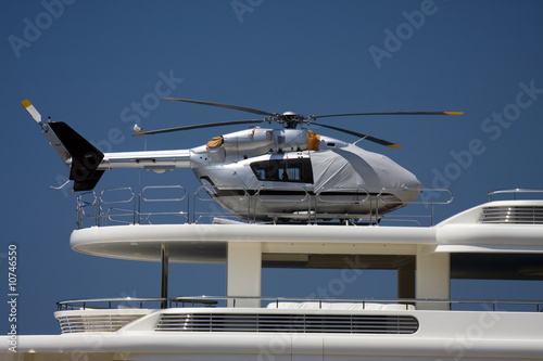 Poster Helicopter Silver helicopter on yacht heliopad