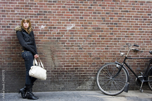 Photo  Young Adult Woman Standing with Purse in Hand