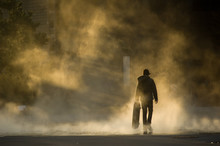 Skateboarder In Mist