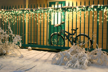 Bicycle, Snow, And Twinkle Lights