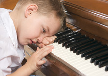 Frustrated Child On The Piano