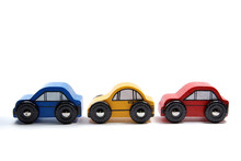 Three Wooden Toy Cars In A Row