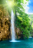 wodospad w głębokim lesie - 11386331