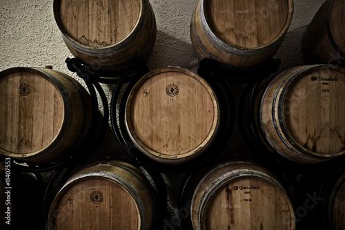 Red wine barrels in cellar in France.