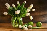 Fototapeta Tulipany - White tulips in glass vase on rustic wood
