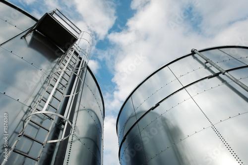 Refinery ladder and tanks Fototapeta