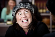 Hispanic Woman With Funny Expr...