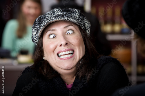 Fototapeta Hispanic woman with funny expression