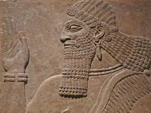 Ancient Assyrian Wall Carving Of A Man Showing His Head And Hand