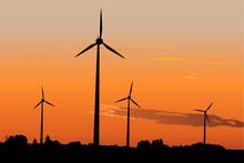 Wind Turbines Against Dramatic Sunset