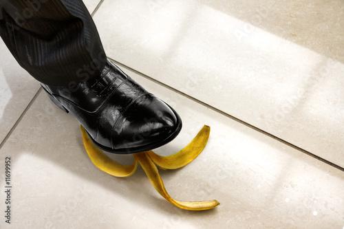 men shoe stepping on banana peel #11699952