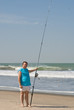Fishing by the breaking Waves