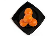 Oranges On Black Plate