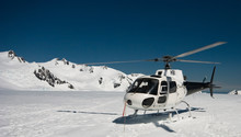 Helicopter Landing On Mountain...