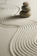 Leinwandbild Motiv Stack of stones on raked sand