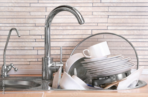 Fototapeta Pile of dirty dishes in the sink obraz