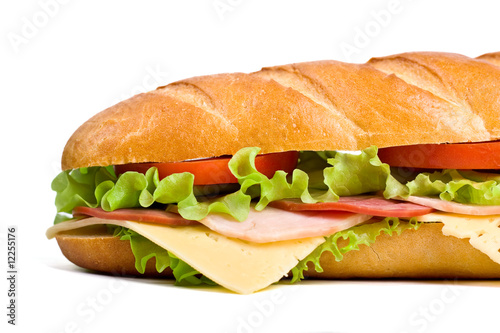 Staande foto Snack baguette sandwich with lettuce, tomatoes, meat and cheese