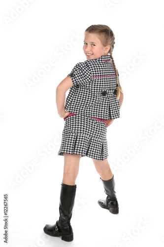 cute young girl in tall black boots and