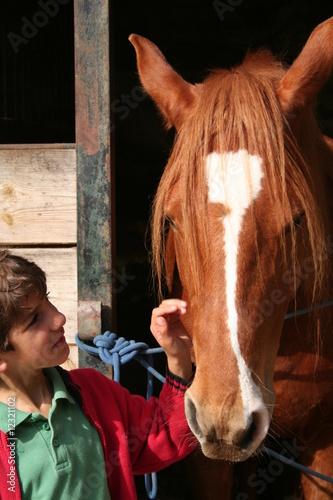 Fototapeta niño con caballo obraz