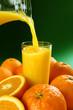 Orange juice on green background