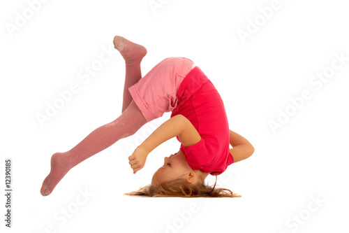 young girl during somersault