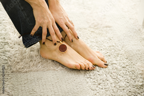woman putting on sexy anklet Canvas Print