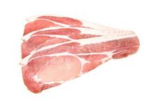 Rashers Of Bacon Isolated On A White Studio Background.