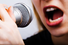 Closeup On Female Singer Mouth And Microphone