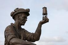 A Statue Of A Coal Miner Looki...