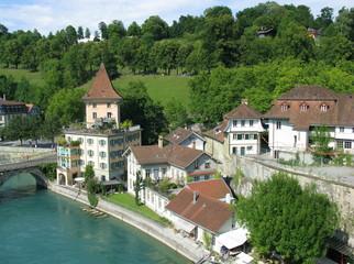 Fototapeta na wymiar Medieval houses by Aare river in Bern, capital of Switzerland.