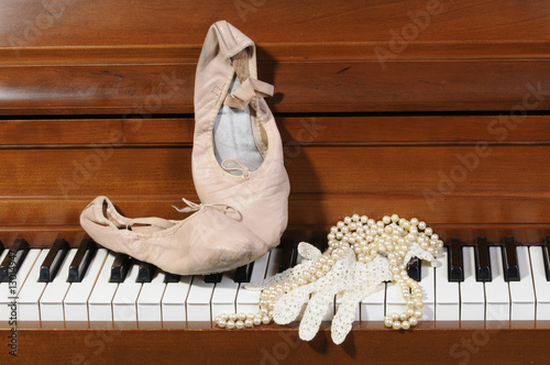 Lace glove and pearls on piano keys Canvas Print