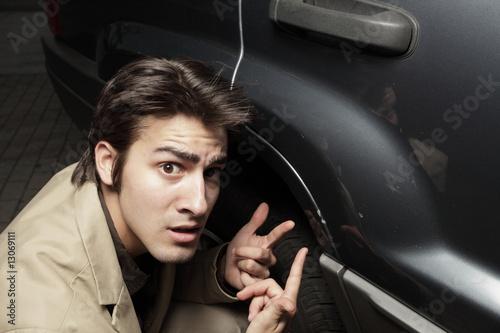 Fotografie, Obraz  Young man upset at the dent in his car