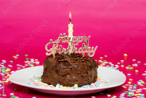 Chocolate Birthday Cake On Pink Focus At Candle